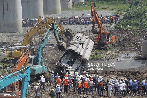 The wreckage of a train carriage lies beneath the bridge at the of the crash involving two trains on July 24 2011 in Wenzhou Zhejiang Province of...