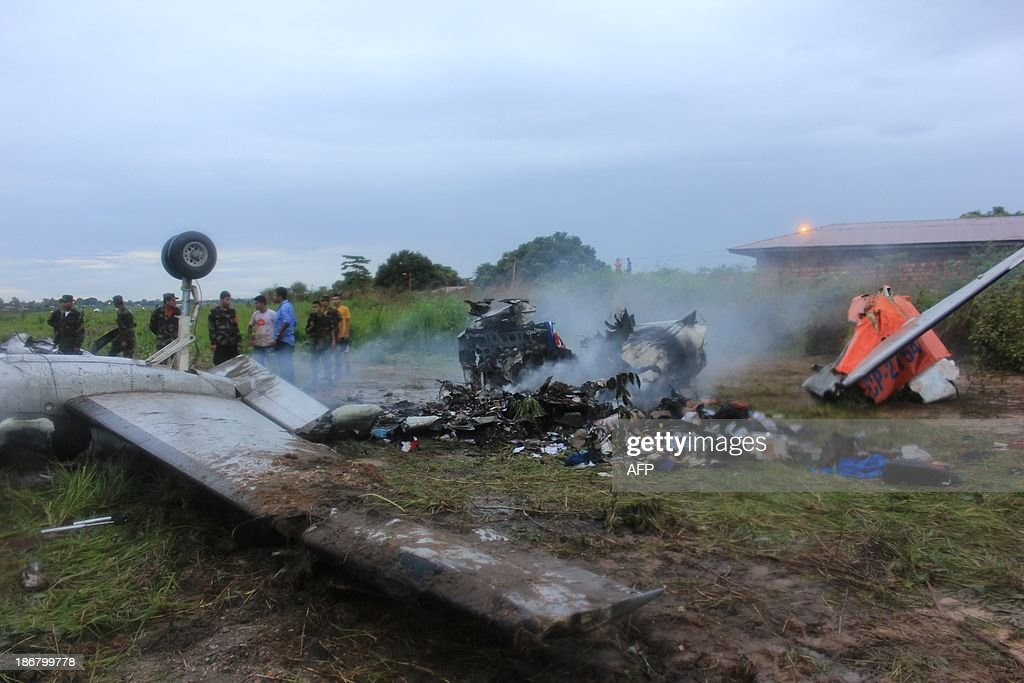 The wreckage of an Aerocon airlines Fairchild Metro 23 turboprop aircraft that crashed on landing in Riberalta, northern Bolivia, near the Brazilian border, on November 3, 2013, leaving eight passengers dead and 10 injured.