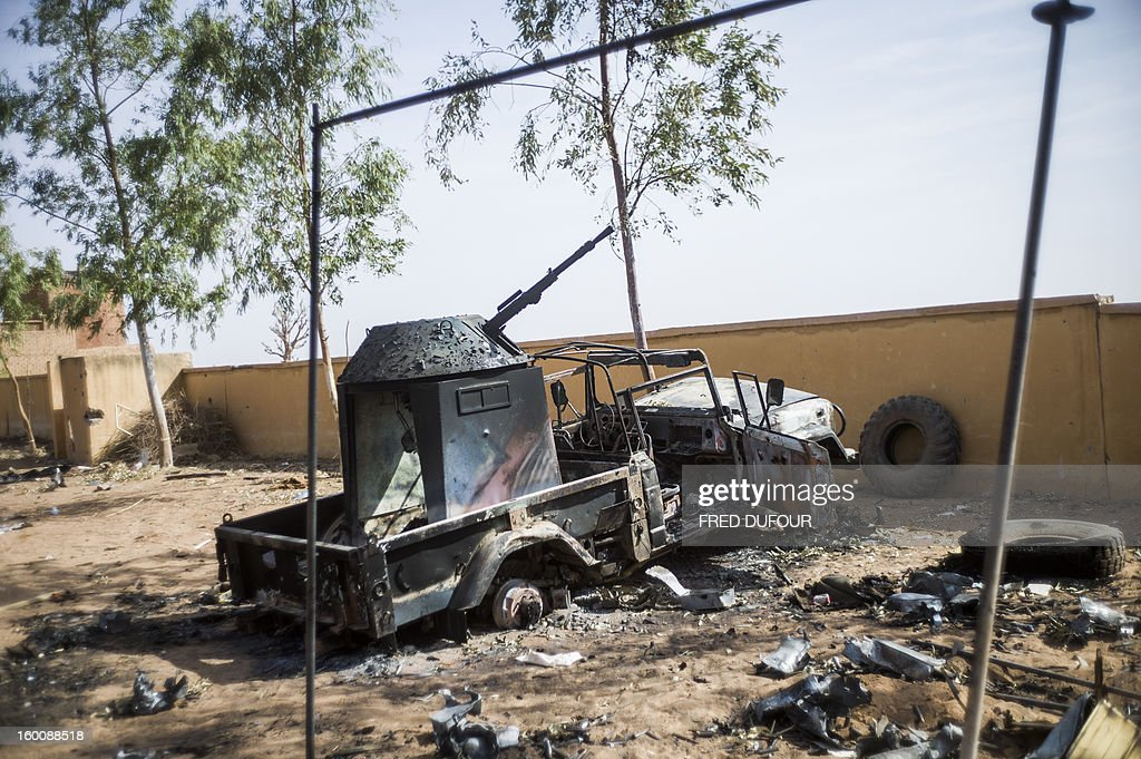 The wreckage of an armed pick up truck is pictured on January 26, 2013 in the key central town of Konna, now controled by French and Malian army since last week after being taken last January 11 by Islamist groups. French and Malian troops pushed north towards the key Islamist strongholds in northern Mali today, as west African defence chiefs gathered in Ivory Coast to review plans to deploy a regional intervention force.