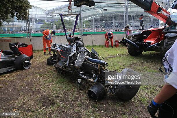 The wreckage of Fernando Alonso's McLaren F1 car is seen after a crash during the Australian Formula One Grand Prix at Albert Park on March 20 2016...