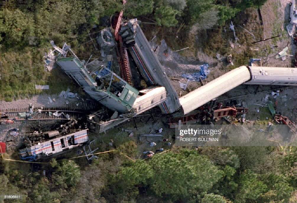 The wreckage of the Amtrak Silver Meteor lies on its side after derailing in Kissimmee, Florida, 30 November 1993, after colliding with a tractor-trailer carrying a 150-ton generator that was stuck on the tracks. An estimated 80 of the 103 three passengers aboard the Tampa, Florida to New York-bound train were hurt in the wreck.