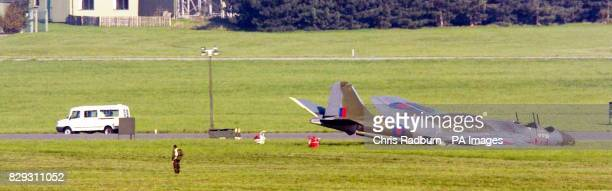 The wreckage of the Canberra aircraft lies on the runway at RAF Marham in Norfolk where it crashed killing two members of its crew A third person...