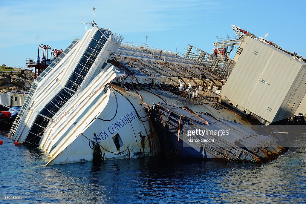 The wreckage of the Costa Concordia sits in the water on September 13, 2013 in Isola del Giglio, Italy. The Costa Concordia is reportedly due to be righted beginning on the morning of September 16, then, if the operation is successful, it will be towed away and scrapped.