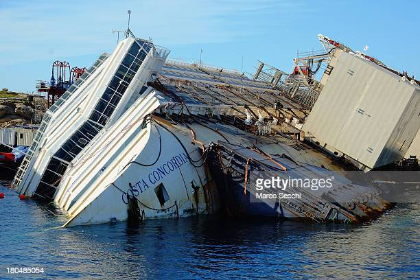 The wreckage of the Costa Concordia sits in the water on September 13 2013 in Isola del Giglio Italy The Costa Concordia is reportedly due to be...