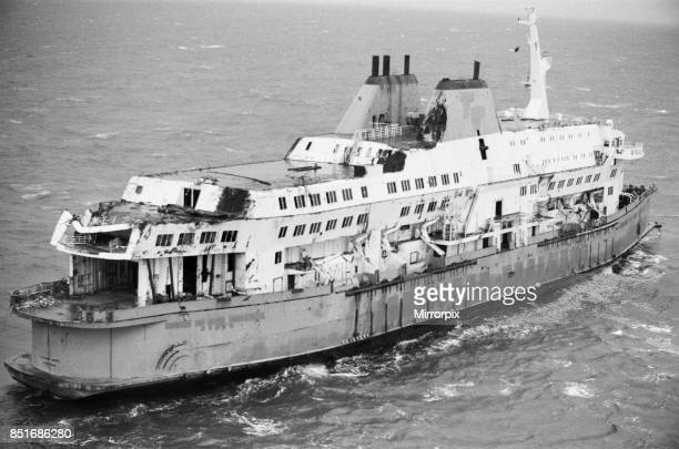 The wreckage of the Herald of Free Enterprise which capsized at Zeebrugge in March 1987 being towed along the English Channel on her final voyage...