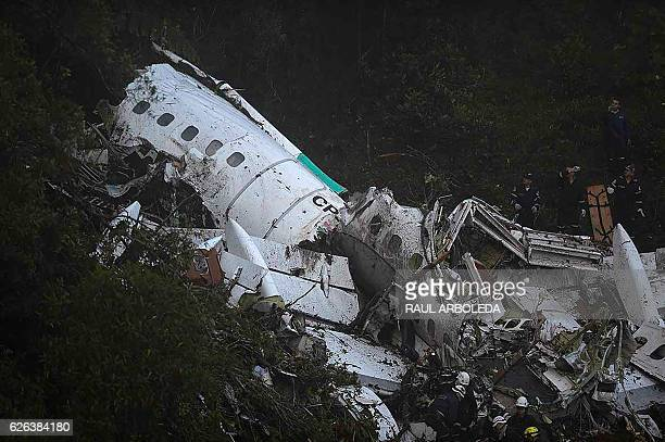 The wreckage of the LAMIA airlines charter plane carrying members of the Chapecoense Real football team is seen after it crashed in the mountains of...