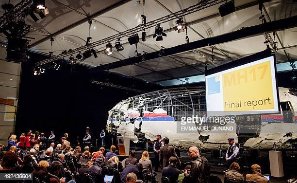 The wreckage of the Malaysia Airlines flight MH17 is exhibited during a presentation of the final report on the cause of the its crash at the Gilze...