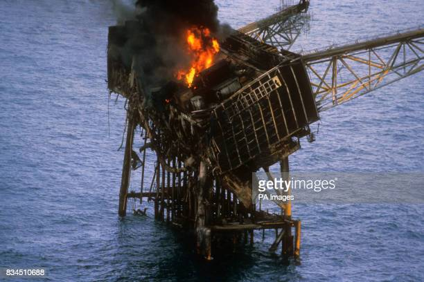 The wreckage of the Piper Alpha oil production platform that exploded yesterday killing dozens of workers on board