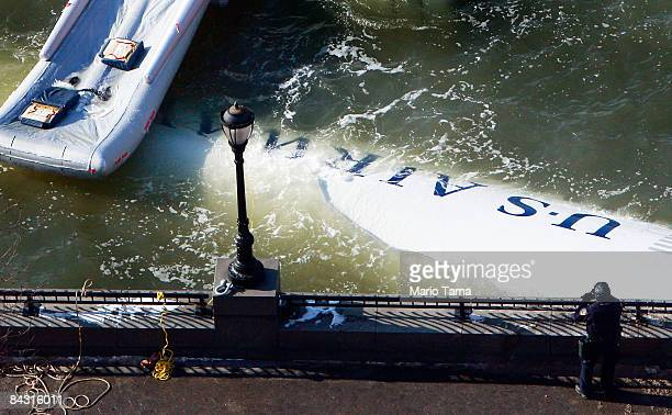 The wreckage of US Airways flight 1549 floats in the Hudson River as investigations into the accident continue on January 16 2009 near Battery Park...