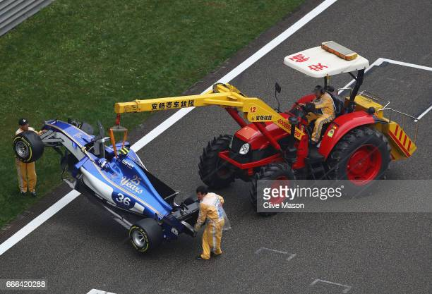 The wrecked car of Antonio Giovinazzi of Italy and Sauber F1 is removed from the track after he crashed during the Formula One Grand Prix of China at...