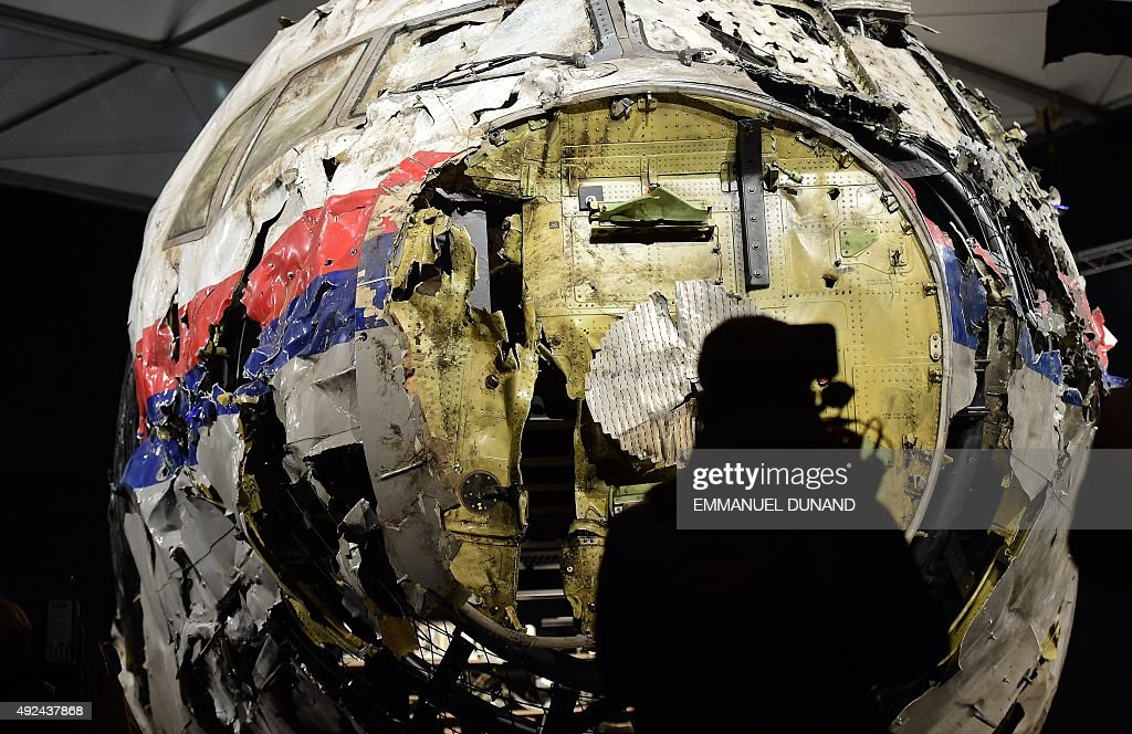 The wrecked cockipt of the Malaysia Airlines flight MH17 is presented to the press during a presentation of the final report on the cause of the its...