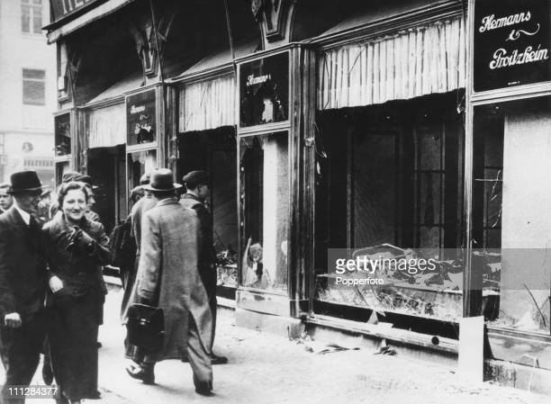 The wrecked front of a Jewishowned shop in Friedrichstrasse Berlin two days after the Kristallnacht pogrom 11th November 1938