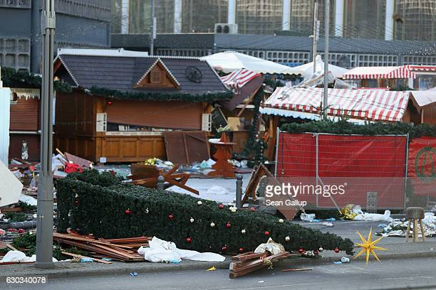 The wrecked remains of the Christmas market stand where two days before a man drove a heavy truck into the market in an apparent terrorist attack on...