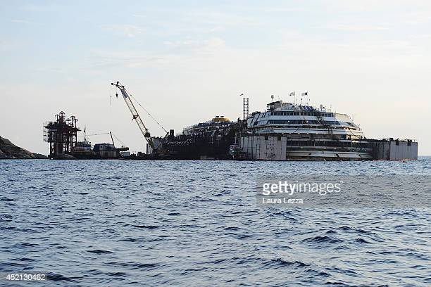 The wrecked ship Costa Concordia with is seen during the refloating operations on July 14 2014 in Isola del Giglio Italy On the first day of the...