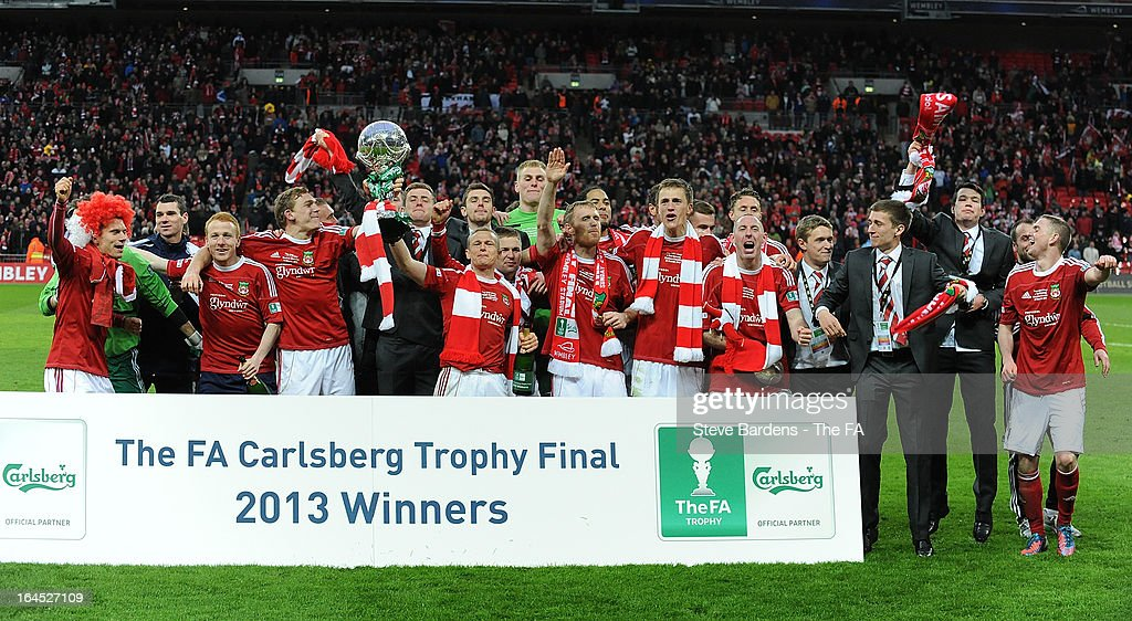 The Wrexham players celebrate their victory with the FA Trophy after winning the FA Trophy Final between Wrexham and Grimsby Town at Wembley Stadium on March 24, 2013 in London, England.