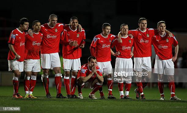 The Wrexham players watch the penalty shoot out during the FA Cup Third Round Replay match between Wrexham and Brighton Hove Albion at the Racecourse...