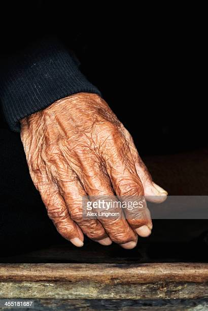The wrinkled and cracked hand of an old fisherman