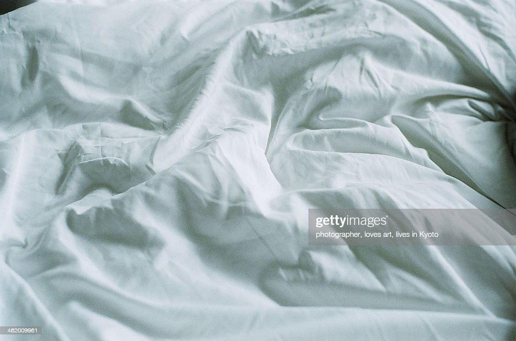 The wrinkled bed sheet : Stock Photo