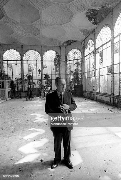 The writer and poet Giorgio Bassani stops in one of the abandoned and decadent rooms of Villa Blanc Bassani intellectual who settled his stories...