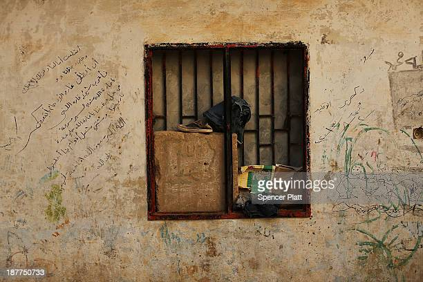 The writings and scribbling of children are viewed on a wall inside of a former prison now being occupied by Syrian refugees in the Bekaa Valley...