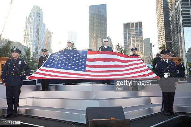 The WTC 9/11 flag is unfurled at the 9/11 Memorial during the tenth anniversary ceremonies of the September 11 2001 terrorist attacks at the World...