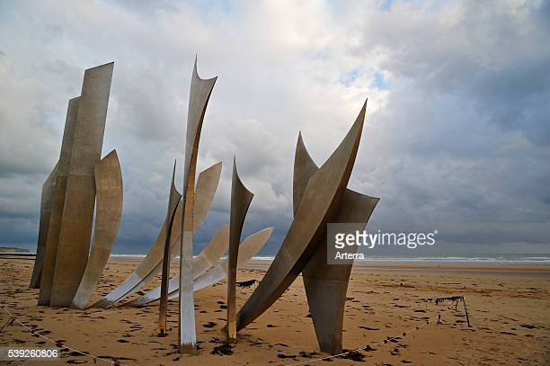 The WW2 American DDay landing Omaha Beach monument Les Braves on the beach at SaintLaurentsurMer at sunset Normandy France