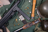 the ww2 german army field equipment with jacket, helmet and machine gun