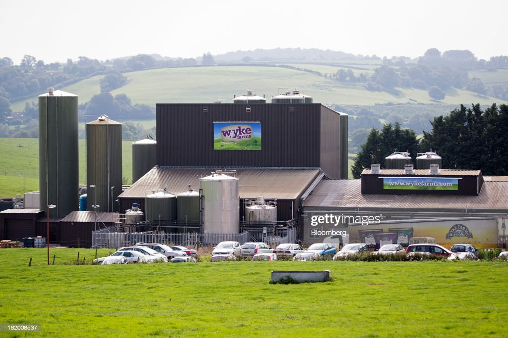 The Wyke cheese and dairy farm is seen at Wyke Farms Ltd., in Bruton, U.K., on Friday, Sept. 27, 2013. Wyke Farms, the U.K.'s largest family-owned cheese maker and milk processor, has started using waste from its cows and pigs to generate clean power and help shave as much as 1 million pounds ($1.6 million) a year off its energy bills. Photographer: Simon Dawson/Bloomberg via Getty Images