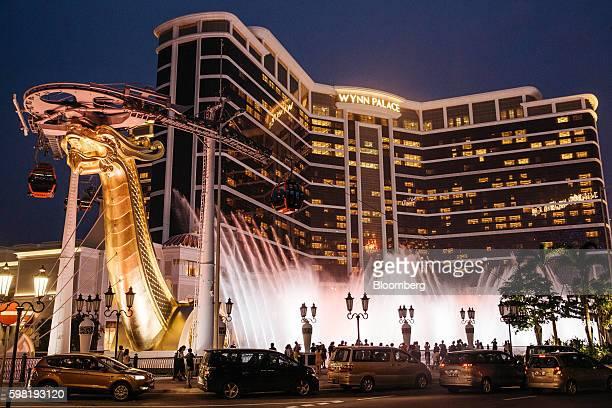 The Wynn Resorts Ltd Wynn Palace casino resort stands illuminated at night in Macau China on Sunday Aug 28 2016 Macau's twoyear economic downturn...