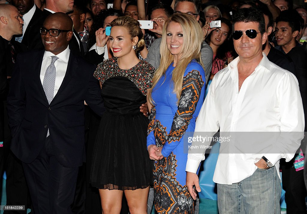 The X Factor judges (L-R) <a gi-track='captionPersonalityLinkClicked' href=/galleries/search?phrase=L.A.+Reid&family=editorial&specificpeople=2546947 ng-click='$event.stopPropagation()'>L.A. Reid</a>, <a gi-track='captionPersonalityLinkClicked' href=/galleries/search?phrase=Demi+Lovato&family=editorial&specificpeople=4897002 ng-click='$event.stopPropagation()'>Demi Lovato</a>, <a gi-track='captionPersonalityLinkClicked' href=/galleries/search?phrase=Britney+Spears&family=editorial&specificpeople=156415 ng-click='$event.stopPropagation()'>Britney Spears</a> and <a gi-track='captionPersonalityLinkClicked' href=/galleries/search?phrase=Simon+Cowell&family=editorial&specificpeople=203007 ng-click='$event.stopPropagation()'>Simon Cowell</a> pose at the premiere of Fox's 'The X Factor' Season 2 and handprint ceremony at the Chinese Theatre on September 11, 2012 in Los Angeles, California.