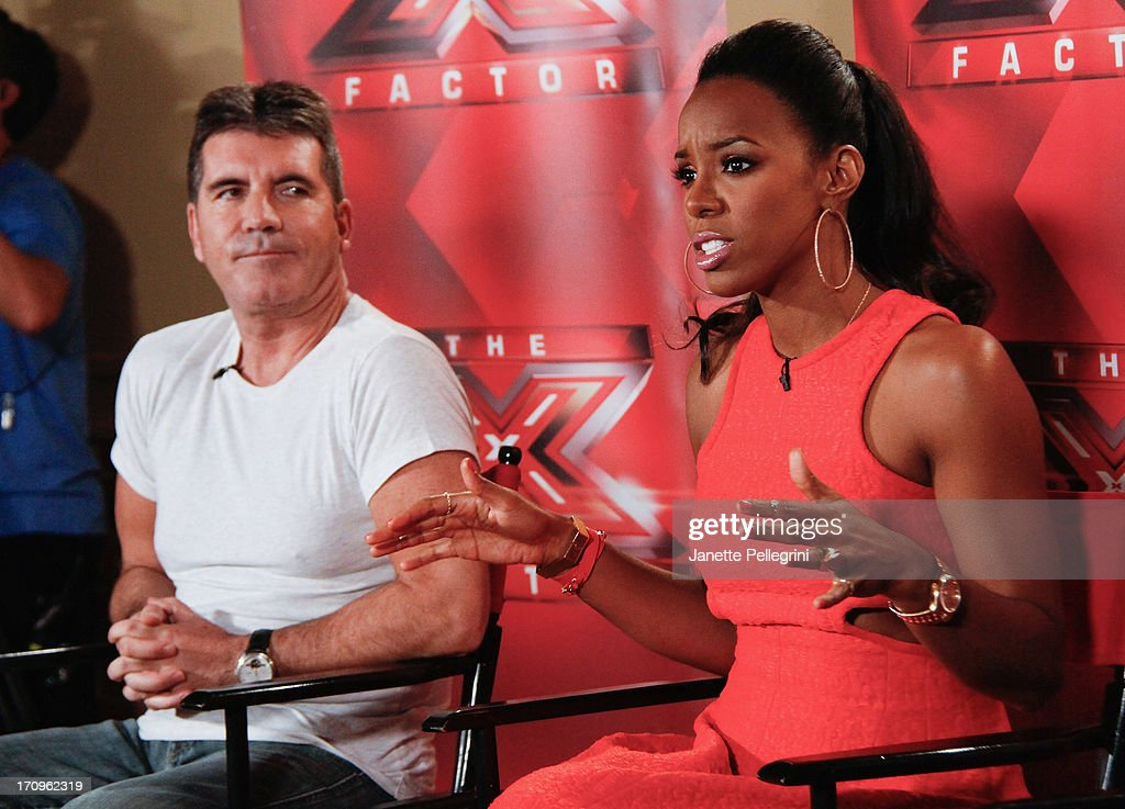 'The X Factor' Judges <a gi-track='captionPersonalityLinkClicked' href=/galleries/search?phrase=Simon+Cowell&family=editorial&specificpeople=203007 ng-click='$event.stopPropagation()'>Simon Cowell</a> and <a gi-track='captionPersonalityLinkClicked' href=/galleries/search?phrase=Kelly+Rowland&family=editorial&specificpeople=201760 ng-click='$event.stopPropagation()'>Kelly Rowland</a> attend the 'The X Factor' Judges press conference at Nassau Veterans Memorial Coliseum on June 20, 2013 in Uniondale, New York.