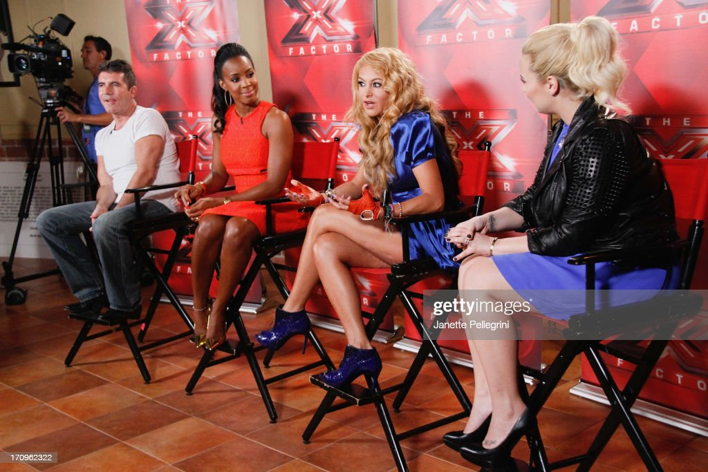 'The X Factor' Judges Simon Cowell, Kelly Rowland, Paulina Rubio and Demi Lovato attend the 'The X Factor' Judges press conference at Nassau Veterans Memorial Coliseum on June 20, 2013 in Uniondale, New York.
