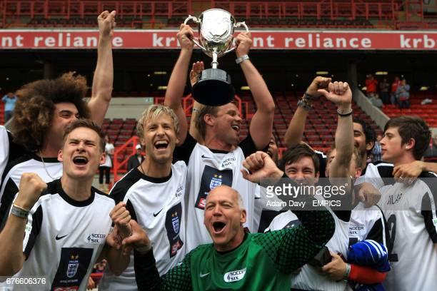 The X Factor team including Jamie Archer Lee Ryan Jeff Brazier and Bob Bolder celebrate winning the Soccer Six football Tournament