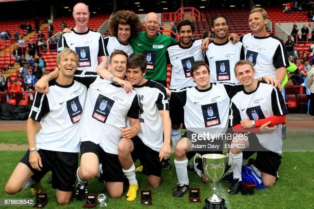 The X Factor team including Jamie Archer Lee Ryan Jeff Brazier Danyl Johnson and Bob Bolder celebrate winning the Soccer Six football Tournament