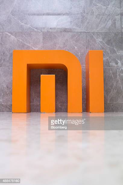 The Xiaomi Corp logo stands on display in the elevator hall at the company's headquarters in Beijing China on Friday Sept 12 2014 Xiaomi Chief...