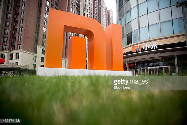 The Xiaomi Corp logo stands outside the company's headquarters in Beijing China on Friday Sept 12 2014 Xiaomi Chief Executive Officer Lei Jun plans...