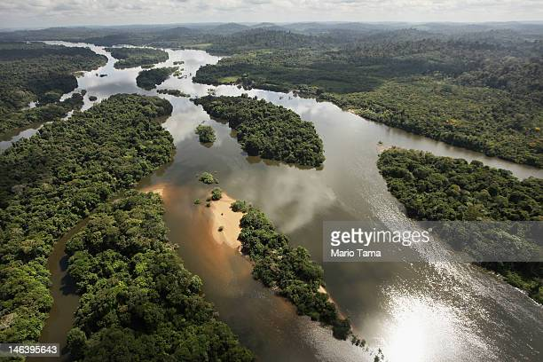 The Xingu River flows near the area where the Belo Monte dam complex is under construction in the Amazon basin on June 15 2012 near Altamira Brazil...