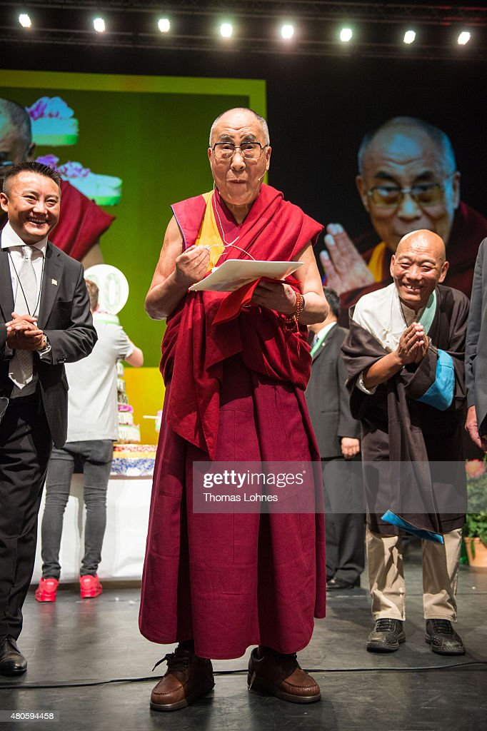 The XIV Dalai Lama eats birthday cake during his 80th birthday celebrations at the 'Jahrhunderthalle' on July 13, 2015 in Frankfurt, Germany.