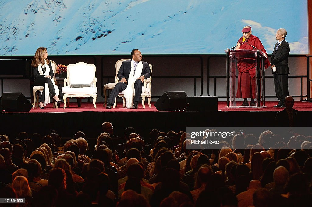 The XIV Dalai Lama presents onstage as Maria Shriver and Inglewood Mayor James T Butts look on at The Forum on February 25 2014 in Inglewood...