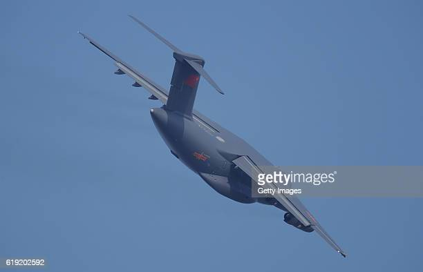 The Y20 strategic transport plane flies ahead of the 11th China International Aviation Aerospace Exhibition on October 29 2016 in Zhuhai Guangdong...