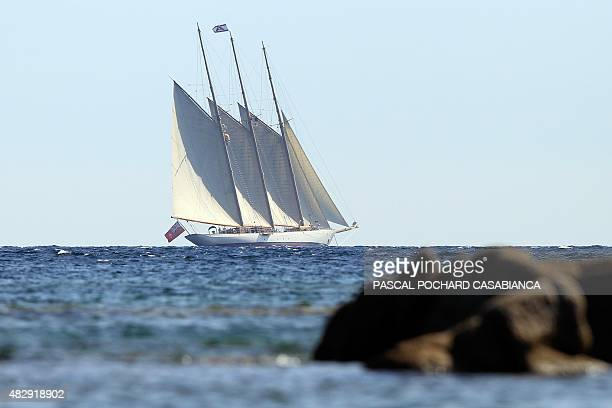 The yacht Adix owned by Spanish Santander banking group and flying a British flag sails off Testa beach on August 4 in Pianottoli Caldarello Corsica...