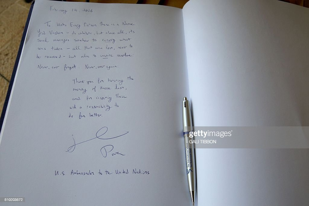The Yad Vashem guest book signed by US Ambassador to the United Nations Samantha Power is seen following her visit to the Yad Vashem Holocaust Memorial museum in Jerusalem commemorating the six million Jews killed by the German Nazis and their collaborators during World War II, on February 14, 2016. / AFP / Gali Tibbon