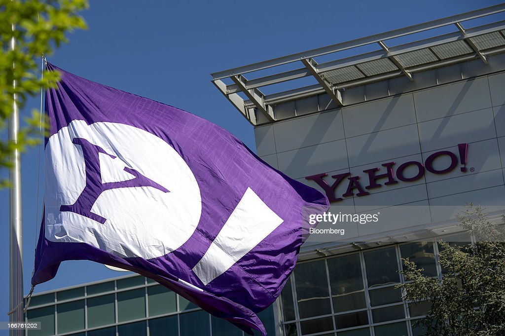 The Yahoo! Inc. logo is displayed on a flag flying at the company's headquarters in Sunnyvale, California, U.S., on Tuesday, April 16, 2013. Yahoo! Inc., the biggest U.S. Web portal, forecast sales that fell short of analysts' estimates as it continued to lose advertisers to Google Inc. and Facebook Inc. Photographer: David Paul Morris/Bloomberg via Getty Images