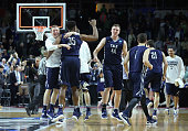 The Yale Bulldogs celebrate defeating the Baylor Bears 7975 during the first round of the 2016 NCAA Men's Basketball Tournament at Dunkin' Donuts...