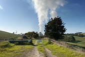 The Yallourn coalfired power station operated by EnergyAustralia Holdings Ltd a unit of CLP Holdings Ltd stands behind a gate as steam billows from...