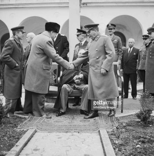 The Yalta Conference February 1945 Winston Churchill shakes hand with Joseph Stalin outside the Livadia Palace during the Yalta Conference President...