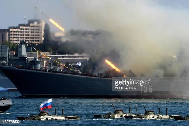 The Yamal a Ropuchaclass landing ship of the Russian Navy fires rockets during Navy Day celebrations in the Crimean city of Sevastopol on July 27...