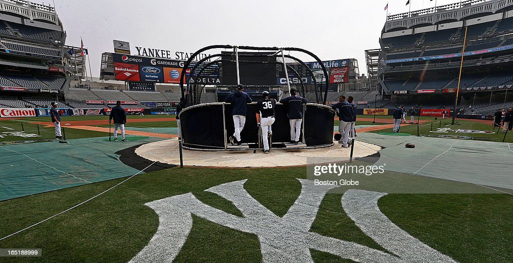 The Yankees Kevin Youkilis (#36) talks to New York Yankees manager Joe Girardi around the batting cage during BP. The Boston Red Sox play the New York Yankees at Yankee Stadium during Opening Day of the 2013 MLB season.