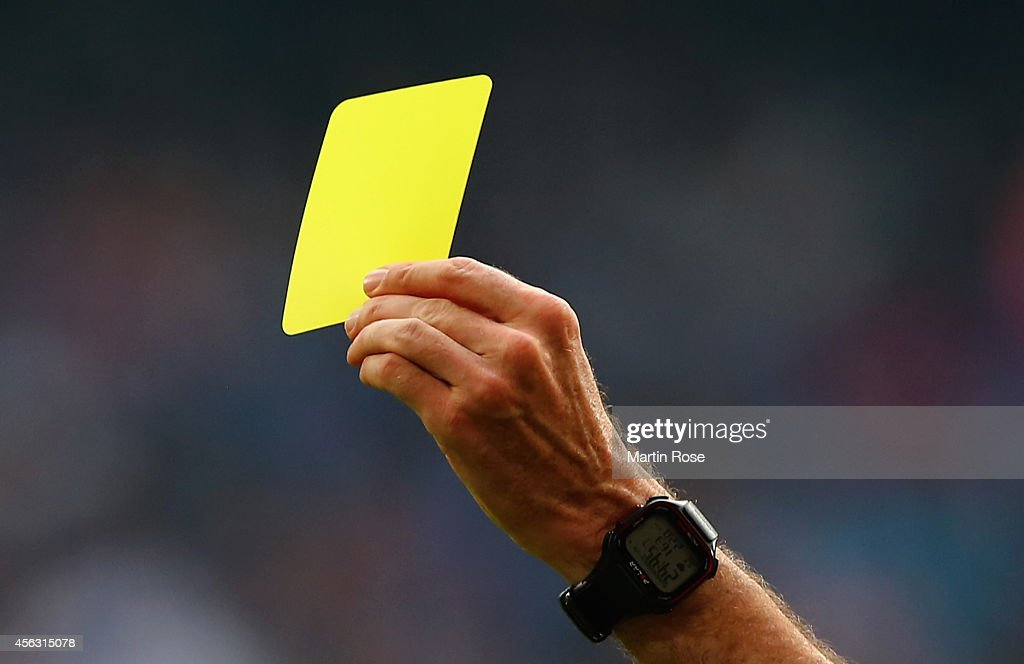The yellow card is pictured during the Bundesliga match between Hamburger SV and Eintracht Frankfurt at Imtech Arena on September 28 2014 in Hamburg...