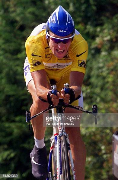 The yellow jersey US Lance Armstrong rides during the 19th stage of the 87th Tour de France an individual timetrial between FreiburgenBrisgau and...